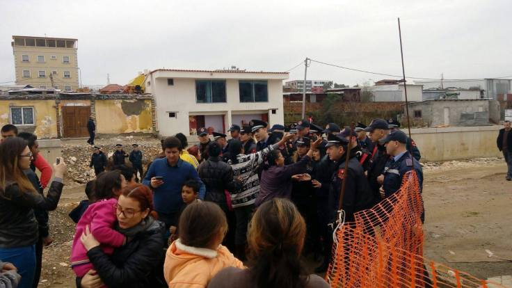 Roma protest the destruction of their homes in Tirana, Albania, outnumbered by police. (c) Brisilda Taco